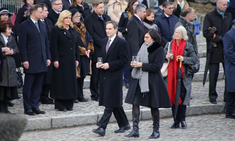 Ambassador Paul Jones lays a candle at the International Monument in Birkenau.