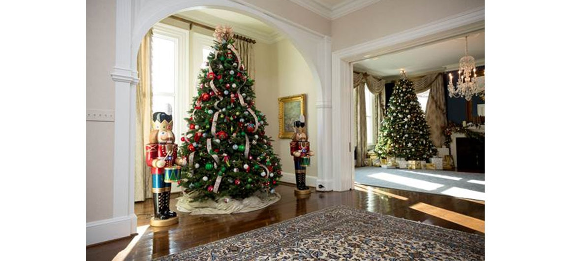 in the foyer a christmas tree stands in the nook decorated with ornaments created - Decorative Christmas Tree Stands