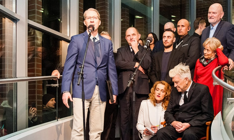 Cultural Attaché Dan Hastings addresses the audience at the opening of an art exhibition by American film director David Lynch in Torun, Poland on November 12