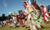 American Indian dancers, wearing eagle feathers and colorful regalia, keep Plains culture alive. (Shutterstock)